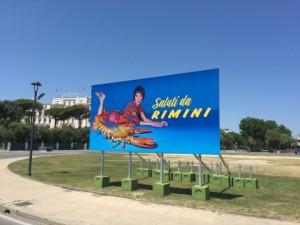 Rimini: scandalo per i manifesti provocanti di Maurizio Cattelan